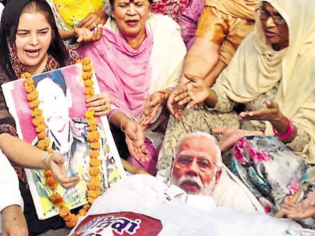 District Mahila Congress workers burning an effigy of Prime Minister Narendra Modi during a protest at Hall Gate in Amritsar on Friday.