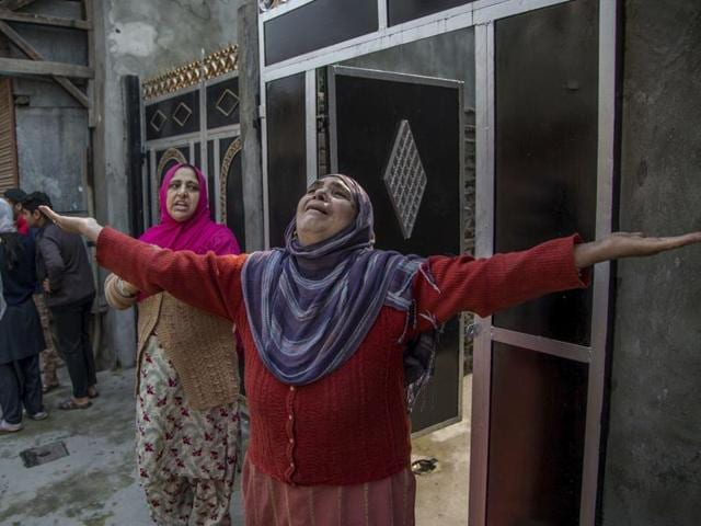 A Kashmiri woman wails during a raid by Indian security personnel in Srinagar. Separatists have accused the security forces of causing the death of Qaisar Sofi, 16.