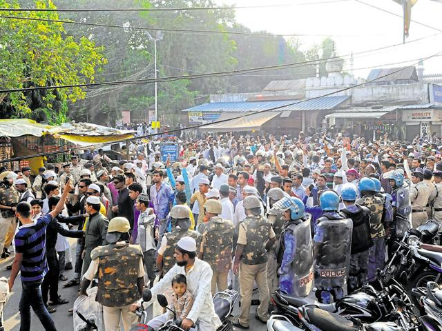 Protesters gather around the Tarjume Wali Masjid, shouting slogans and demanding justice for the slain SIMI operatives in Bhopal on Friday.
