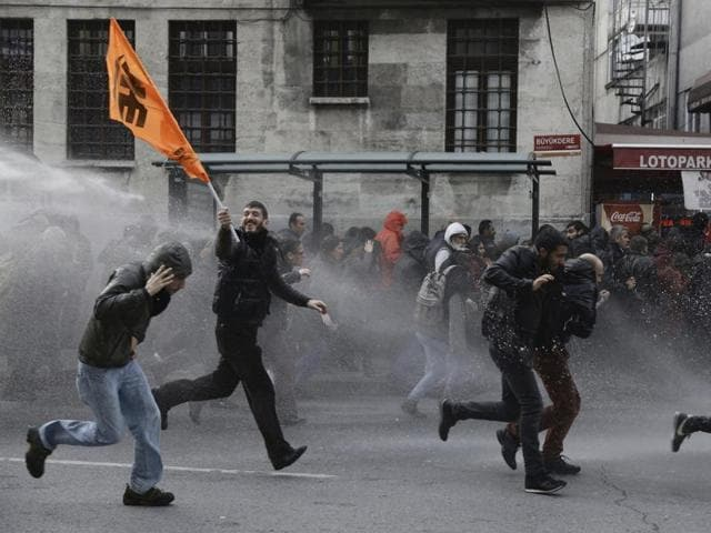 Riot police use water cannons to disperse protesters during a protest against the arrest of pro-Kurdish Peoples' Democratic Party (HDP) lawmakers, in Istanbul.