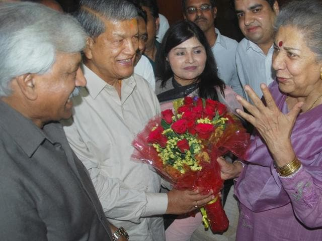 Uttarakhand chief minister Uttarakhand chief minister Harish Rawat  welcomes Congress state in-charge Ambika Soni.