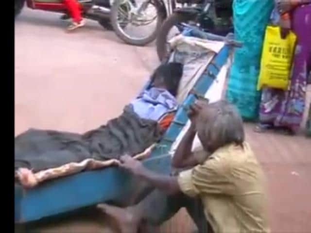 A 53-year-old beggar was forced to push a cart carrying his dead wife's body for more than 80 kilometres.