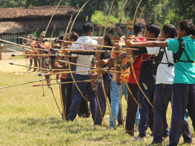 Tribal children at a practice session in Shivtarai village. With 94 medals at state and national events, they now aim for international fame.