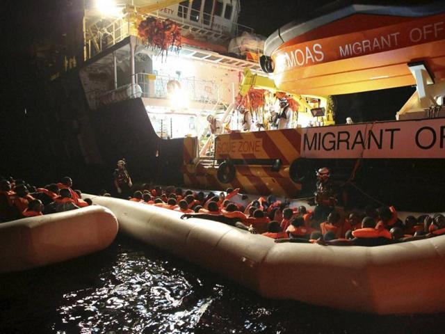 Migrants on dinghy boats are rescued by the vessel Responder, run by the Malta-based NGO Migrant Offshore Aid Station (MOAS) and the Italian Red Cross, in the Mediterranean sea.(AP Photo)