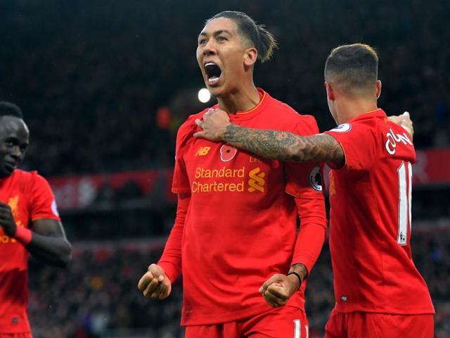 Liverpool's Georginio Wijnaldum celebrates scoring their sixth goal with team mates.