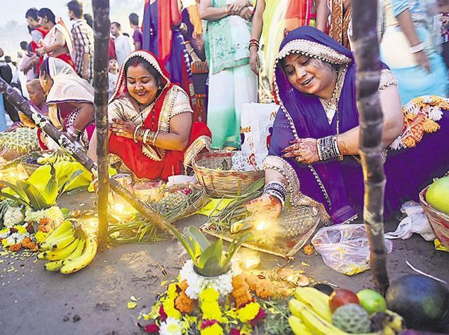 Women perform Chhat Puja at Juhu beach on Sunday.