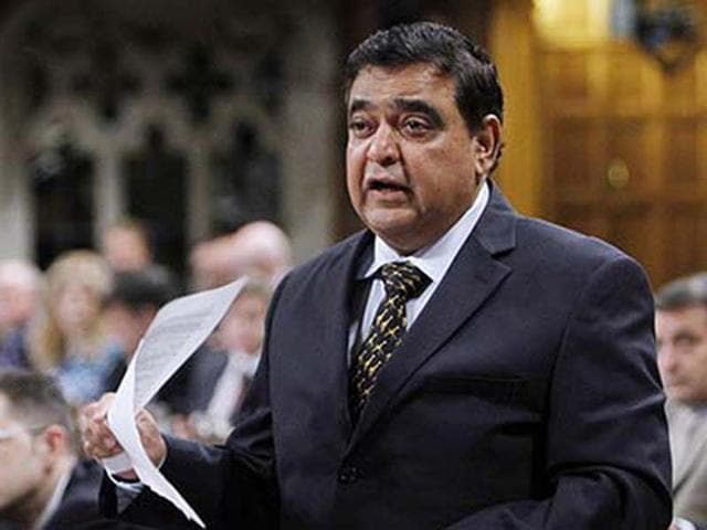 Conservative MP Deepak Obhrai stands in the House of Commons during question period.