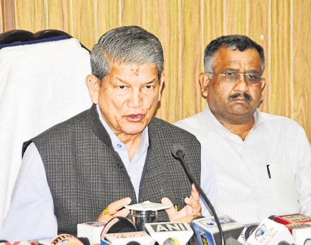 Chief minister Harish Rawat addresses a press conference in Dehradun.