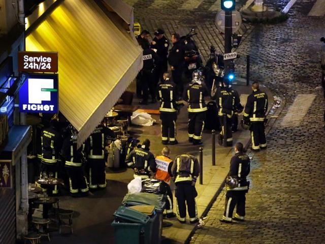 This file photo taken in the night of November 14, 2015 shows police outside a cafe-restaurant in 10th arrondissement of the French capital Paris, on November 13, 2015.