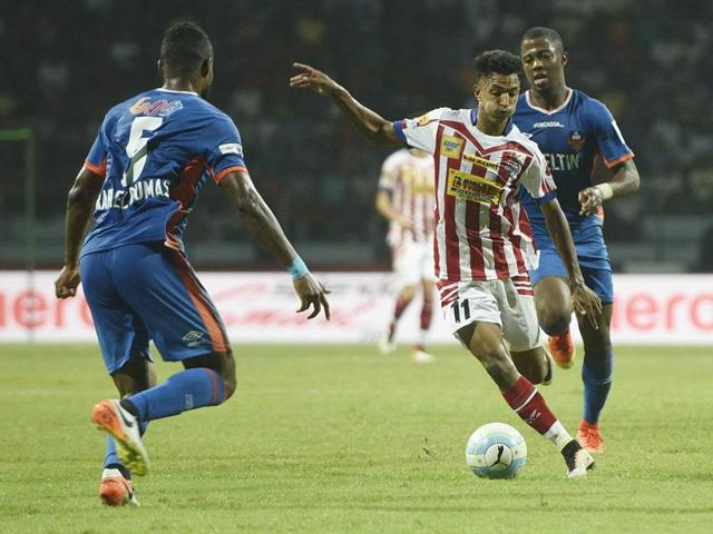 Atletico de Kolkata player Sameegh Doutie with his teammate jubilate after scoring a goal.