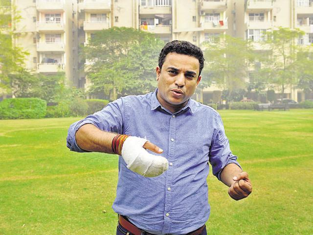 Sandeep Yadav burnt his hand as he moved two cylinders to safety when fire broke out at Raheja Teachers Apartment.