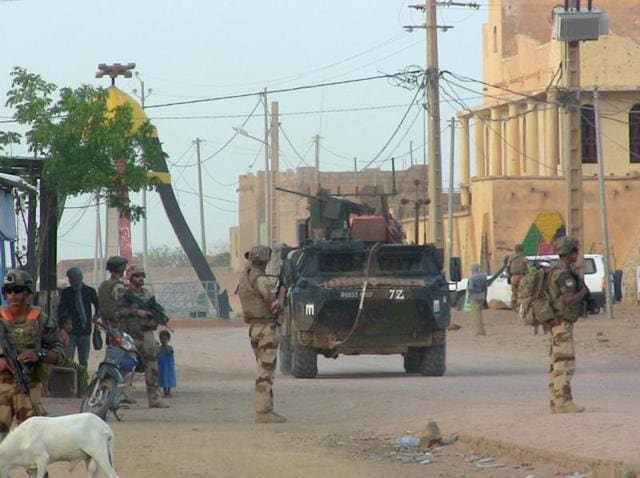 French soldiers of the Barkhane counter terrorism operation patrol in a street of Kidal.