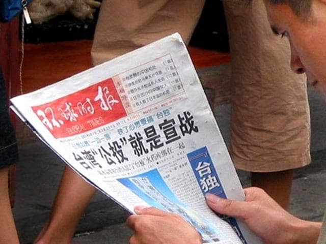 A man reading the Global Times newspaper in Shanghai.