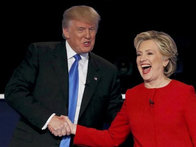 Republican US presidential nominee Donald Trump shakes hands with Democratic US presidential nominee Hillary Clinton at the conclusion of their first presidential debate at Hofstra University in Hempstead, New York.