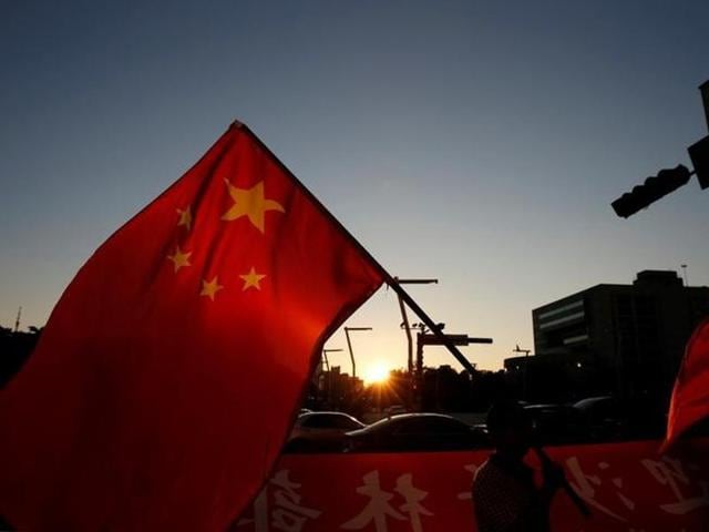 A picture of the Chinese national flag.