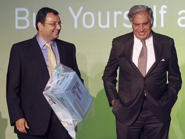 In this 2012 file photo, Ratan Tata and Cyrus Mistry attend the launch of a new website for tech superstore Croma, in Mumbai.