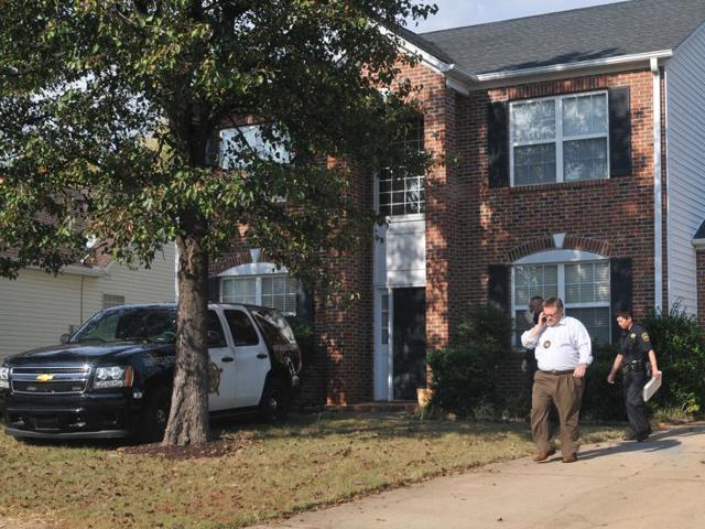 In this Nov 3 photo, registered sex offender Todd Christopher Kohlhepp's home is searched by Spartanburg County Sheriff's deputies and his vehicles are impounded in Moore.