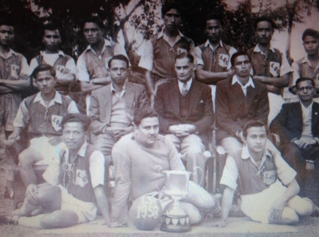 Herbert Winston Vaughan (sitting on floor with trophy and football) with teammates in Aizawl.