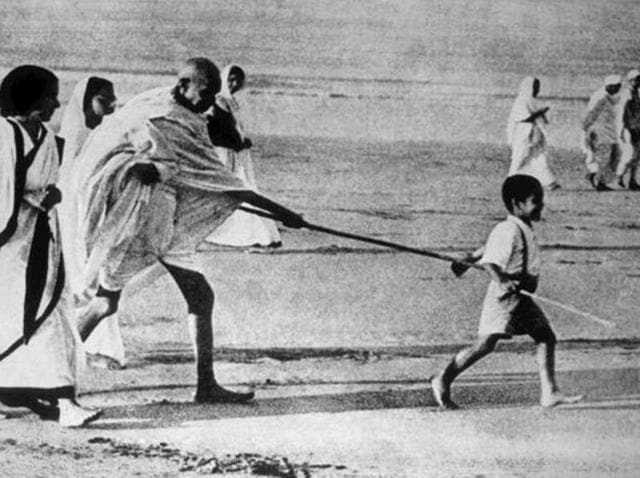 Mahatma Gandhi with grandson Kanu on the beaches of Gujarat's Dandi village during the historic Salt Satyagraha of March-April 1930.(Vithalbhai Jhaveri/Dinodia Pho)