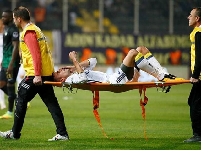 Robin Van Persie leaves on a stretcher after being injured during the Turkish Spor Toto Super Lig match.