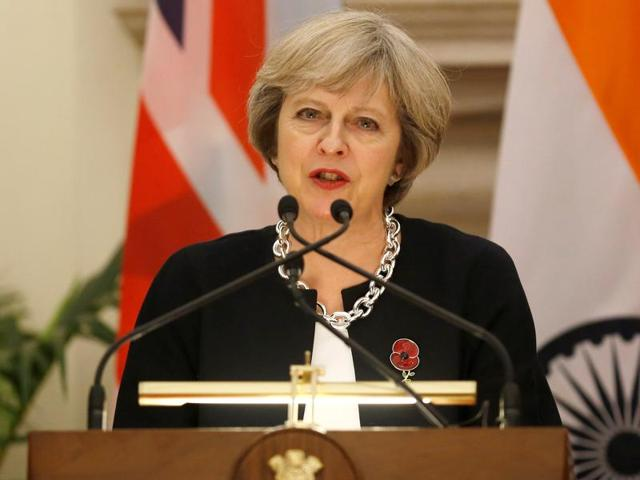 Britain's Prime Minister Theresa May reads a joint statement with her Indian counterpart Narendra Modi (not in frame) at Hyderabad House in New Delhi.