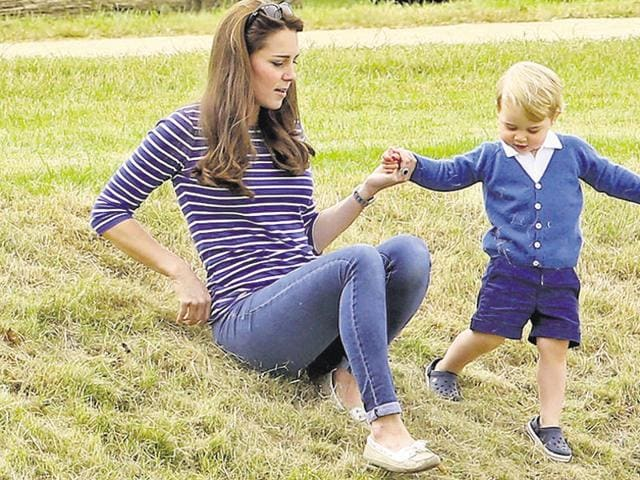 Catherine Duchess of Cambridge, with Prince George wearing a pair of crocs in England on June 14, 2015.
