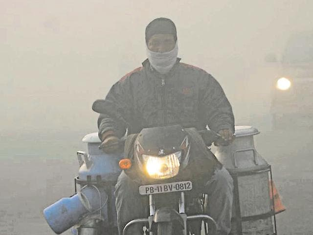 Commuters were seen having a hard time making their way through thick fog at Pehowa Road in Patiala on Sunday.