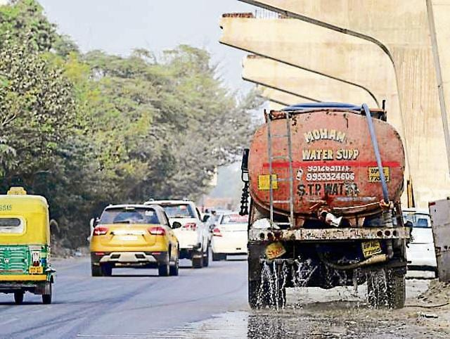The authority sprinkled water on roads to contain spread of dust, following the DM's orders.