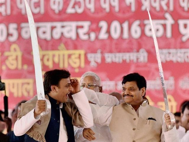 Uttar Pradesh chief minister Akhilesh Yadav and his uncle and Samajwadi Party state president Shivpal Yadav are all smiles on the stage during the party's silver jubilee celebration programme at Janeshwar Mishra Park in Lucknowon November 5, 2016.