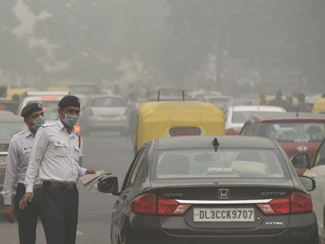 Traffic policemen wear masks as pollution reaches hazardous levels in New Delhi on Sunday.