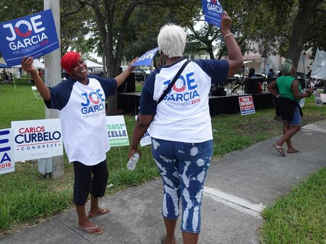 """People confer during an event called """"Souls to the Polls"""" on November 6, 2016 in Cutler Bay, Florida, which aims to encourage minority voter turnout in the key swing state of Florida."""