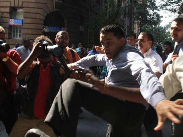 Several photojournalists were beaten up by the Bombay House security guards and the list included a photojournalist from Hindustan Times.