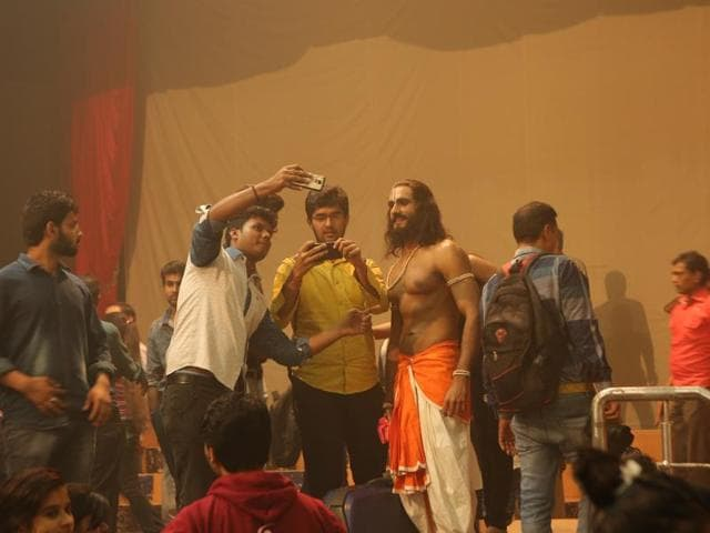 Students of Hans Raj colleges take selfies with the characters of the play.