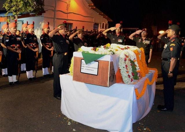 Army personnel pay respects to Naik Rajendra Narayan Tupare, who was martyred in Krishna Ghati Sector, at Sambra Airport in Belgaum, Karnataka on Monday.