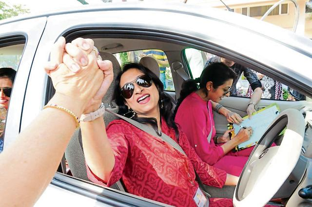 Woman sarpanch Bhakti Sharma takes part in women car rally in Bhopal on Sunday.