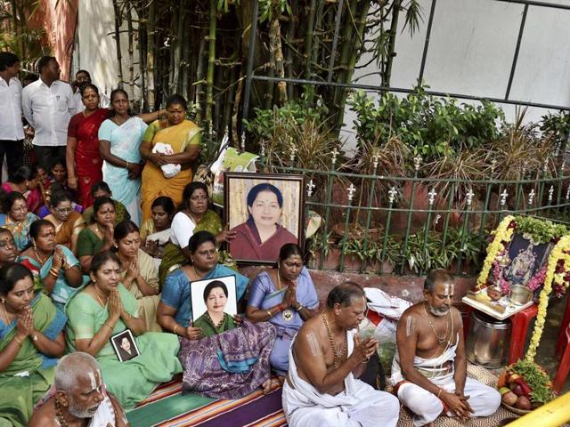 AIADMK women wing members pray for speedy recovery of party supremo and chief minister J Jayalalithaa, in front of Apollo hospital in Chennai.
