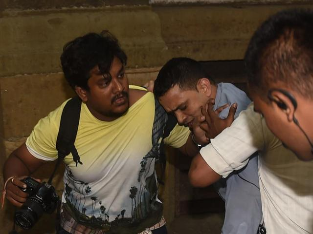A photojournalist being beaten up by Bombay House security guards on Friday.