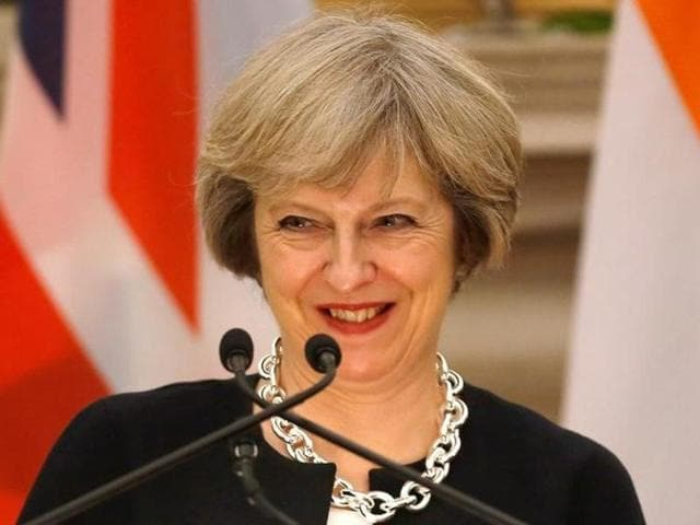 Britain's Prime Minister Theresa May smiles as her Indian counterpart Narendra Modi (not pictured) reads a joint statement at Hyderabad House in New Delhi.