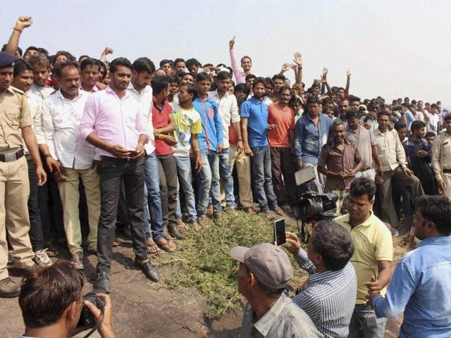 Locals surround the encounter site at Acharpura hillocks near Khijradev village on Octobr 31.
