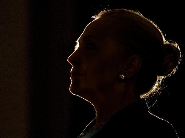 U.S. Secretary of State Hillary Clinton is silhouetted by a stage light as she speaks at the University of the Western Cape about the U.S.-South Africa partnership, in Cape Town August 8, 2012.