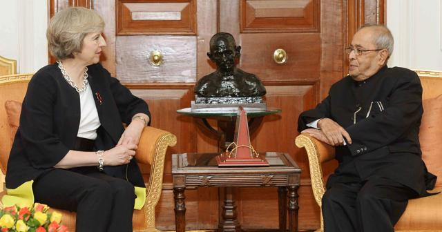 Britain's Prime Minister Theresa May (L) speaks with India's President Pranab Mukherjee during a meeting at Rashtrapati Bhawan in New Delhi. Britain's Prime Minister Theresa May has pledged to make it easier to do business with India, seeking to boost trade with the world's fastest growing major economy ahead of Brexit, but gave little ground on a key visa demand.