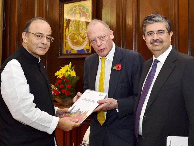Finance minister Arun Jaitley with co-chairs of the India UK Financial Partnership, Uday Kotak and Gerry Grimstone, during a meeting in New Delhi on Monday.