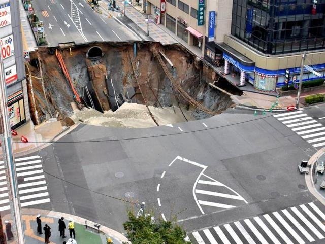A huge sinkhole is seen at an intersection near Hakata station in Fukuoka, Japan.