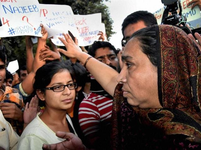 Missing JNU student Najeeb's mother along with students holding a protest outside Delhi Police headquarters in New Delhi on Monday.