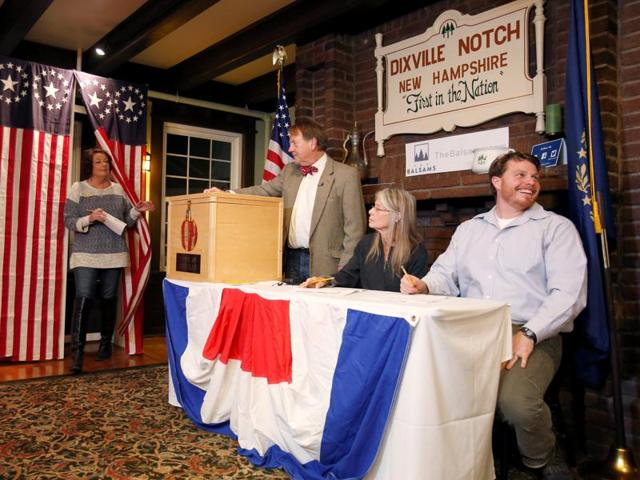 Nancy DePalma, a Dixville Notch resident who registered to vote just after midnight, leaves the voting booth after casting her ballot in the US presidential election in tiny Dixville Notch, New Hampshire.