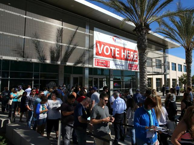 People line up to vote early outside the San Diego County Elections Office in San Diego, California.