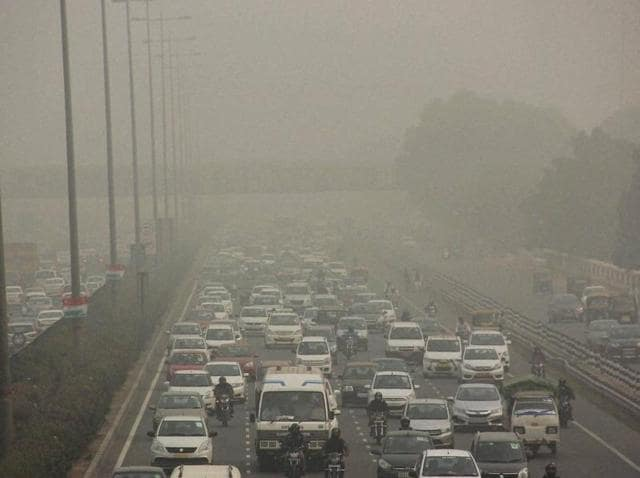 Vehicles ply on Gurgaon-Delhi Expressway through dense smog in Gurugram on Monday.