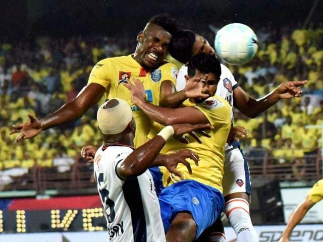 Players of Kerala Blasters FC (Yellow Jersey) and FC Goa in action during their match.