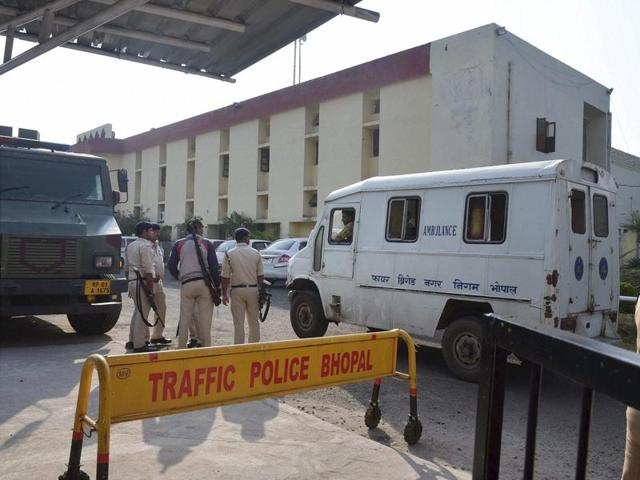 Police personnel outside the Bhopal Central Jail after 8 SIMI members escaped, in Bhopal.