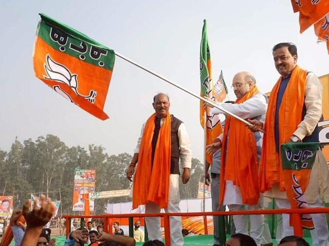 BJP president Amit Shah along with party leader Keshav Prasad Maurya and others at the party's Parivartan Rally in Robertsganj on Tuesday.